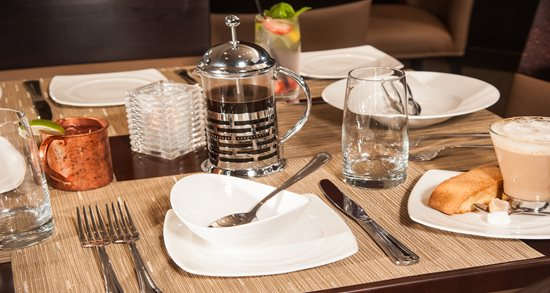 Ken Stewart's East Bank place-setting and custom flatware